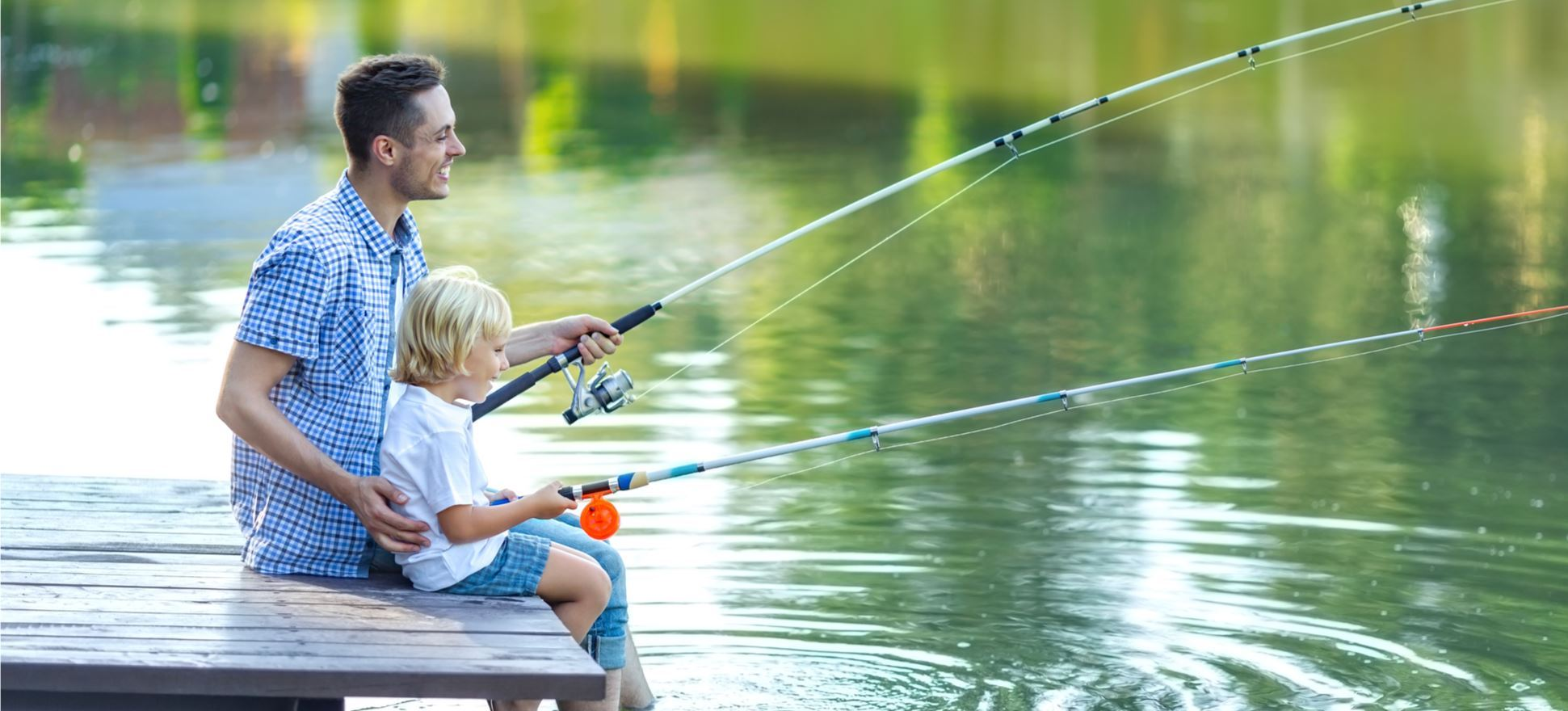 Parent and child fishing together